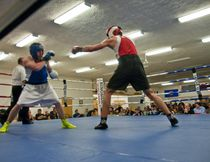 Blue Ridge Boxing Club's Randy Thompson fights with Ben Alvarez from Edmonton's Panther Boxing Club in the main event fight during Saturday, March 22nd's fight night in Whitecourt. Bryan Passifiume | QMI Agency