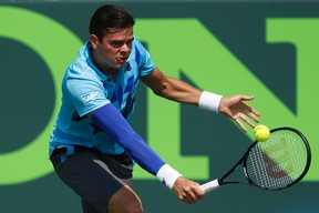 Milos Raonic hits a backhand against Guillermo Garcia-Lopez (not pictured) on day eight of the Sony Open at Crandon Tennis Center on Mar 24, 2014 in Miami, FL, USA. (Geoff Burke/USA TODAY Sports)