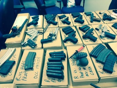 Toronto Police Service photo of seized firearms in alleged trafficking investigation. Donald Earl Hare, 44, and Amanda Brent, 43, both of Proton Station, Ontario, have been charged with 73 firearm and firearm-trafficking-related charges.