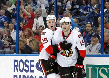 Mar 24, 2014; Tampa, FL, USA; Ottawa Senators center Zack Smith (15) is congratulated by Ottawa Senators right wing Chris Neil (25) after he scored a goal during the first period against the Tampa Bay Lightning at Tampa Bay Times Forum. Mandatory Credit: Kim Klement-USA TODAY Sports