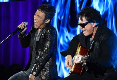 Arnel Pineda (L) and Neal Schon of rock band Journey, who are among the bands at the 2014 Ottawa Bluesfest. They're scheduled for Friday, July 4 at 8 p.m. REUTERS/Phil McCarten