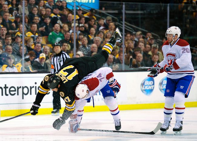 Montreal Canadiens defenceman Alexei Emelin hip checks Boston Bruins left wing Milan Lucic at TD Garden in Boston, March 24, 2014. (BOB DeCHIARA/USA Today)