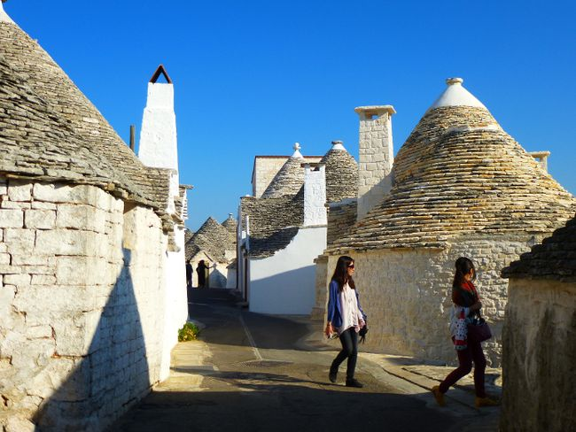 Tourists walk among the trulli in Alberobello.The large settlement of dry stone houses is one of the largest and best preserved in the world. ROBIN ROBINSON/TORONTO SUN