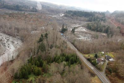 An aerial view of the landslide that is covering State Route 530 near Oso, Washington March 23, 2014, is seen in this picture provided by Washington State Department. The known death toll stood at 24, with as many as 176 people still unaccounted for near the rural town of Oso, where a rain-soaked hillside collapsed on Saturday and cascaded over a river and a road, engulfing dozens of homes on the opposite bank.  Picture taken March 23, 2014.  REUTERS/Washington State Department of Transportation/Chris Johnson/Handout via Reuters