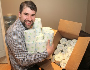 Morgan Pierce, a financial advisor, has launched a campaign to gather 100,000 rolls of donated toilet paper for the St. Vincent de Paul Society, where clients are given a single roll each month in a household supplies basket. Michael Lea The Whig-Standard