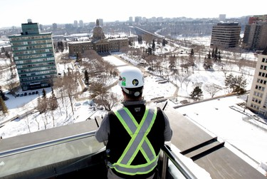 Sean McCullough looks out over the Alberta Legislature grounds from the top floor of the Federal Building, 9820 - 107 St., in Edmonton Alta., on Friday March 28, 2014. The building is still under renovation. The top floor would have be a private suite for the Premier had plans for the suite not been cancelled. David Bloom/Edmonton Sun/QMI Agency