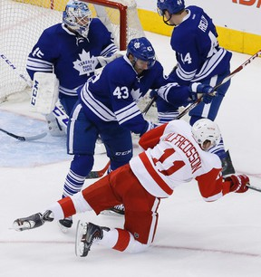 Maple Leafs forward Nazem Kadri lowers the boom on the Red Wings' Daniel Alfredsson at the Air Canada Centre last night. (Stan Behal/Toronto Sun)