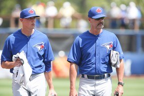 Pitching coach Pete Walker, talking with young hurler Aaron Sanchez, breaks down the strengths and weaknesses of the five-man Jays rotation. (Veronica Henri, Toronto Sun)