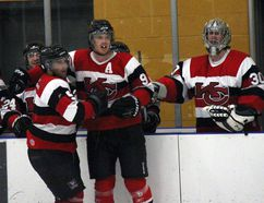 Komoka Classics Ryan Stephenson (9) and Ryan Fletcher (5) celebrate a goal vs. Tillsonburg during the WOAA Sr. AA South Final. The Classics won the series in five games and will take on the Mapleton-Minto 81's in the league final beginning this weekend. JACOB ROBINSON/AGE DISPATCH/QMI AGENCY