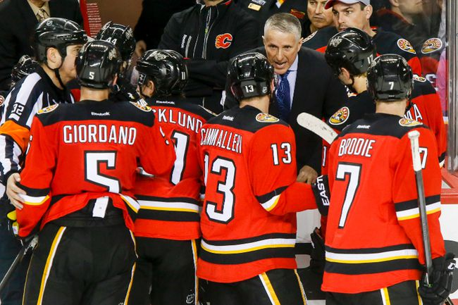Calgary Flames head coach Bob Hartley rallies his troops during a timeout against the New York Rangers during NHL action last Friday at the Saddledome. Photo by Lyle Aspinall/Calgary Sun