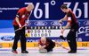 Canada's skip Kevin Koe (C) delivers a stone between his teammates in a match against the United States during their World Men's Curling Championships in Beijing, April 1, 2014. (REUTERS)