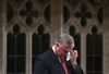 Liberal MP Jim Karygiannis wipes his eyes while announcing his resignation in the House of Commons on Parliament Hill in Ottawa April 1, 2014. REUTERS/Chris Wattie