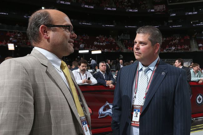 Boston Bruins general manager Peter Chiarelli (left) and the Maple Leafs' Dave Nonis talk during the 2013 NHL Draft. ( Bruce Bennett/Getty Images/AFP)