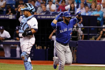 Toronto Blue Jays right fielder Jose Bautista (19) reacts after he hit a solo home run during the seventh inning against the Tampa Bay Rays on April 2. (Kim Klement-USA TODAY Sports)