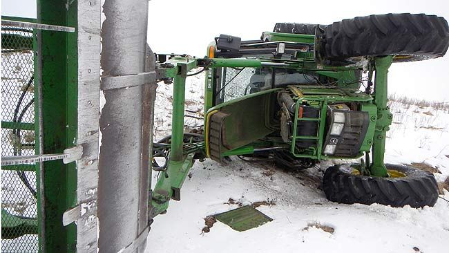RCMP arrested a man after this tractor rolled near Blackfalds, Alta., on April 2, 2014. (RCMP handout/QMI Agency)