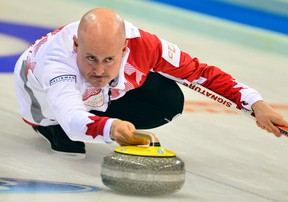 Canada skip Kevin Koe delivers a rock during his match against Scotland at the World Men's Curling Championships in Beijing, April 3, 2014. (REUTERS/China Daily)