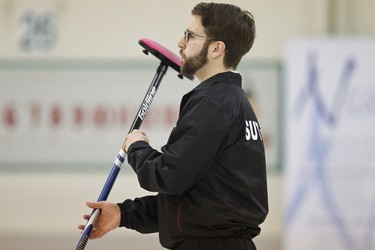 Edmonton 1 Kris Sutton spins his broom during the first frames of the 2014 Canadian Gay Curling Championships at Granite Curling Club in Edmonton, Alta., on Thursday, April 3, 2014. The championships run through April 6, and involve teams from across the country. Ian Kucerak/Edmonton Sun/QMI Agency
