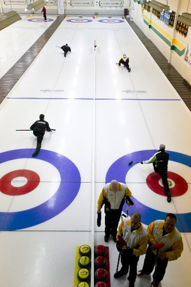 Curlers warm up prior to the start of the 2014 Canadian Gay Curling Championships at Granite Curling Club in Edmonton, Alta., on Thursday, April 3, 2014. The championships run through April 6, and involve teams from across the country. Ian Kucerak/Edmonton Sun/QMI Agency