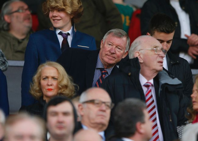 Manchester United's former manager Alex Ferguson (C) looks on ahead of their English Premier League soccer match against Aston Villa at Old Trafford in Manchester, northern England March 29, 2014. (REUTERS/Phil Noble)