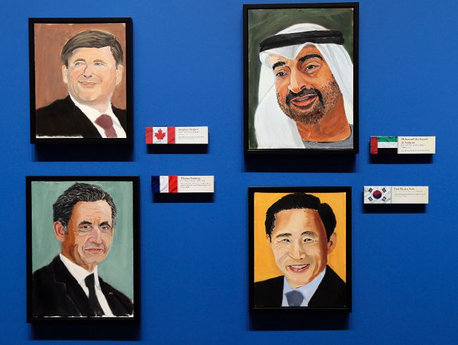 "Portraits of world leaders (clockwise from top-left) Prime Minister Stephen Harper, Crown Prince of Abu Dhabi Mohamed bin Zayed Al Nahyan, former French President (2007-2012) Nicolas Sarkozy and former South Korean President (2008-2013) Lee Myung-bak, painted by former U.S. President George W. Bush, hang on display during ""The Art of Leadership: A President's Personal Diplomacy"" exhibit at the George W. Bush Presidential Library and Museum in Dallas, Texas April 4, 2014. REUTERS/Brandon Wade"