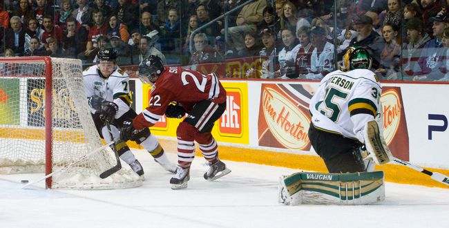 Guelph Storm forward Pius Suter scores a shorthanded wrap-around goal while under pressure from London Knights forward Chris Tierney after catching Knights goaltender Jake Patterson too far out of his net during game 1 of the OHL Western Conference semi-finals at the Sleeman Centre in Guelph, Ontario on Friday April 4, 2014.