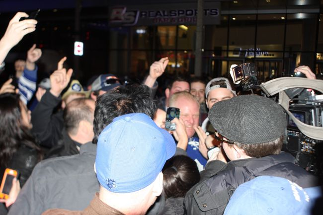 Mayor Rob Ford is mobbed by fans outside the Air Canada Centre Saturday night. (JOE WARMINGTON/Toronto Sun)