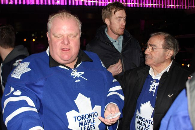 Mayor Rob Ford and Councillor Frank DiGiorgio, far right, at the Leafs game on April 5. (JOE WARMINGTON/Toronto Sun)