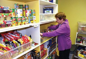 In this January 2013 Advocate file photo, Vulcan Regional Food Bank manager Brenda English stocks the shelves. The food bank society has been raising funds for a new location with more space.