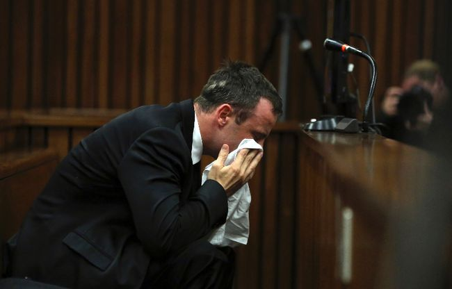 Oscar Pistorius reacts during his trial at the high court in Pretoria on April 7, 2014. (REUTERS/Themba Hadebe/Pool)