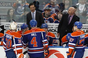 Dallas Eakins, seen here behind the bench during a game against the Ducks March 28, says he assured Anaheim coach Bruce Boudreau he didn't send players out to pick fights on Sunday. (Ian Kucerak, Edmonton Sun)