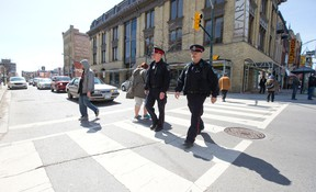 Police officers walk the beat in downtown London. (Free Press file photo)