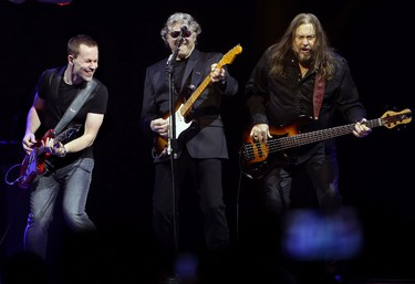 (left to right) The Steve Miller Band's Jacob Petersen, Steve Miller, and Kenny Lee Lewis perform at Rexall Place, in Edmonton Alta., on Monday April 7, 2014. David Bloom/Edmonton Sun/QMI Agency