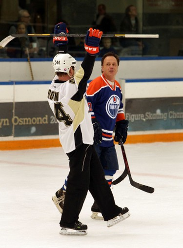 Oilers alumni Rob Brown (l) and Dave Lumley celebrate a goal.  Edmonton Oilers alumni reunite for a friendly game against the media to launch Alzheimer�s Face Off at West Edmonton Mall in Edmonton, Alberta on Monday, Apr 8, 2014.  The Alzheimer Society of Alberta and Northwest Territories brings pro-am hockey event back to Edmonton, April 11 � 13, 2014.  This will mark the official kick-off for the annual pro-am tournament, which raises critical research dollars for the Alzheimer Society.    Perry Mah/ Edmonton Sun/ QMI Agency