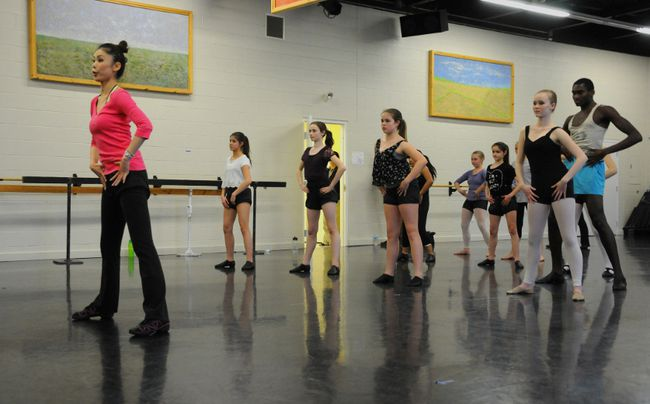 Riyo Mori, left, who held the Miss Universe title in 2007, stop by the Quinte Ballet School of Canada in Belleville, Ont. Monday, April 7, 2014 to teach a workshop for the current professional students. - Megan Mattice, For The Intelligencer