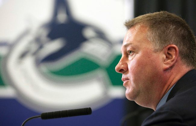 Vancouver Canucks general manager Mike Gillis speaks at a news conference in Vancouver, British Columbia June 17, 2011, two days after losing to the Boston Bruins in Game 7 of the Stanley Cup Finals. (REUTERS/Ben Nelms)