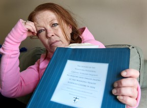 Lauren Maguire, whose son Jesse died at the HSC in 1994, holds a copy of the inquest report in Winnipeg, Man. April 8, 2014. Maguire is upset that the health minister attempted to use infant deaths for political gain. (Brian Donogh/Winnipeg Sun)