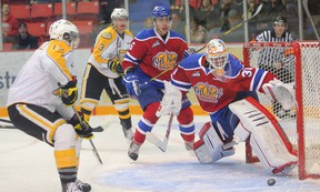 Edmonton Oil Kings goaltender Tristan Jarry slides across the ice to block a shot from Brandon Wheat Kings John Quenneville  during Game 3 of the their WHL play-off series at Westman Place in Brandon, Man., on Apr. 8. (Bruce Bumstead, Brandon Sun)