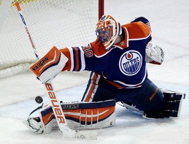 Edmonton Oilers goalie Ben Scrivens (30) makes a stick save against the Colorado Avalanche during first period NHL action at Rexall Place in Edmonton Alberta, Alta., on Tuesday April 8, 2014. David Bloom/Edmonton Sun/QMI Agency