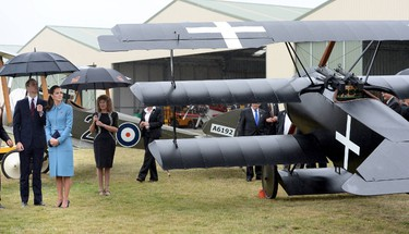 Britain's Catherine, Duchess of Cambridge (2nd L) and her husband Prince William look at a Fokker plane, part of a static WWI display. at the Omaka Aviation Heritage Centre near Blenheim, in New Zealand April 10, 2014. The Prince and his wife Kate are undertaking a 19-day official visit to New Zealand and Australia with their son George.  REUTERS/Anthony Devlin/Pool