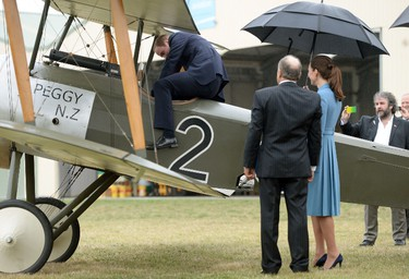 Britain's Catherine, Duchess of Cambridge watches her husband Prince William climb into the cockpit of a Sopwith Pup at the Omaka Aviation Heritage Centre near Blenheim, in New Zealand April 10, 2014. The Prince and his wife Kate are undertaking a 19-day official visit to New Zealand and Australia with their son George.  REUTERS/Anthony Devlin/Pool