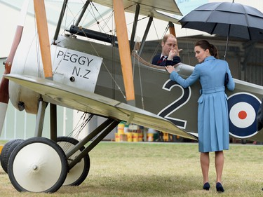 Britain's Catherine, Duchess of Cambridge watches Prince William in the cockpit of a Sopwith Pup at the Omaka Aviation Heritage Centre near Blenheim, in New Zealand April 10, 2014. The Prince and his wife Kate are undertaking a 19-day official visit to New Zealand and Australia with their son George.  REUTERS/Anthony Devlin/Pool