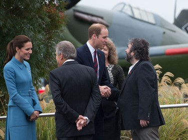 Britain's Prince William (C) and Catherine, the Duchess of Cambridge (L), meet New Zealand film maker Peter Jackson (R) during a visit to the Omaka Aviation Heritage Centre in Blenhiem on April 10, 2014.  William, Kate and their son Prince George are on a three-week tour of New Zealand and Australia.  AFP PHOTO / MARTY MELVILLE