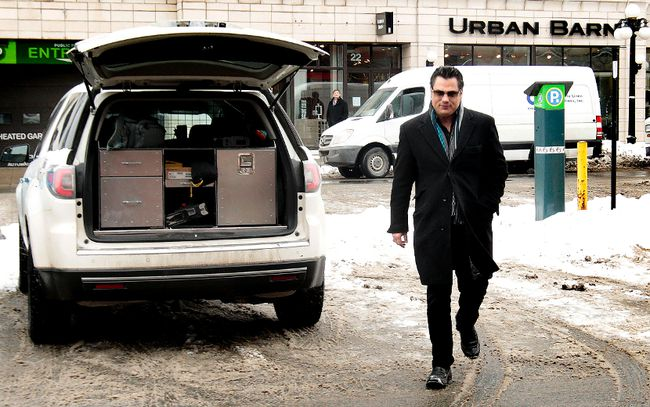 Suspended Conservative senator Patrick Brazeau has found work as the day manager at BareFax Gentlemen's Club. Brazeau arrives at his new job in the Market in Ottawa On. Tuesday Feb 19, 2014. (Tony Caldwell/QMI Agency)