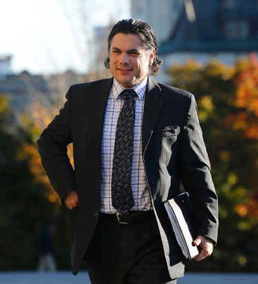 """Senator Patrick Brazeau arrives on Parliament Hill in Ottawa October 25, 2013.  Canada's main opposition leader, Thomas Mulcair, leader of the official opposition New Democratic Party, accused Prime Minister Stephen Harper on Wednesday of creating a """"culture of corruption"""" as Harper faced an expenses scandal that looked to be spiraling into the biggest crisis of his seven years in office. REUTERS/Chris Wattie"""