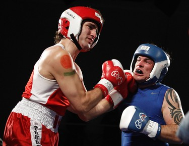 Liberal Member of Parliament Justin Trudeau (L) and Conservative Senator Patrick Brazeau fight during their charity boxing match in Ottawa in this March 31, 2012 file photo. Trudeau, who will likely be crowned Liberal leader on Sunday, has captured enough affection that the Liberals are nudging the ruling Conservatives off top spot in the polls. REUTERS/Chris Wattie/Files