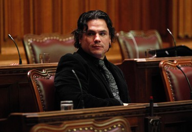 Conservative Senator Patrick Brazeau waits for the start of a royal assent ceremony in the Senate chamber on Parliament Hill in Ottawa in this December 14, 2012 file photo. Brazeau has been removed from the Conservative caucus after police arrested the Senator following an alleged domestic assault at his Gatineau residence according to reports.    REUTERS/Chris Wattie/Files