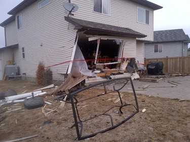 A woman driving a car was badly hurt when the car hit a house in Spruce Grove. (RCMP PHOTO)