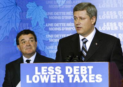 Prime Minister Harper and finance minister Jim Flaherty make an announcement on government debt and taxes at the CRA building in Toronto. Michael Peake/QMI Agency