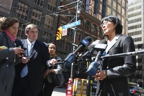 Toronto mayoral candidate Olivia Chow holds a press conference about traffic gridlock at the corner of Wellington and York Sts on April 10, 2014. (Veronica Henri/Toronto Sun)