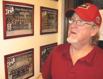<p>Brian Tardiff checks out the wall of fame photos at Ontario Hockey Academy in Cornwall, on April 10, 2014.</p><p>TODD HAMBLETON/CORNWALL STANDARD-FREEHOLDER/QMI AGENCY